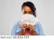 Купить «excited african american woman with dollar money», фото № 30933737, снято 2 марта 2019 г. (c) Syda Productions / Фотобанк Лори