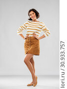 young woman in striped pullover, skirt and shoes. Стоковое фото, фотограф Syda Productions / Фотобанк Лори
