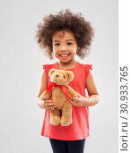 Купить «happy little african american girl with teddy bear», фото № 30933765, снято 9 марта 2019 г. (c) Syda Productions / Фотобанк Лори