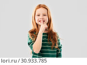 Купить «smiling red haired girl making shush gesture», фото № 30933785, снято 9 марта 2019 г. (c) Syda Productions / Фотобанк Лори