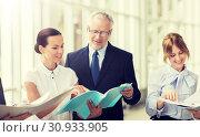 Купить «business team with folders meeting at office», фото № 30933905, снято 3 июля 2016 г. (c) Syda Productions / Фотобанк Лори