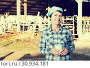 Купить «Active woman is holding glass of milk», фото № 30934181, снято 24 октября 2017 г. (c) Яков Филимонов / Фотобанк Лори