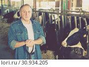 Купить «Portrait of male farmer who is standing», фото № 30934205, снято 24 октября 2017 г. (c) Яков Филимонов / Фотобанк Лори