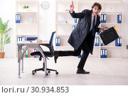 Купить «Young male employee in the office in time management concept», фото № 30934853, снято 8 января 2019 г. (c) Elnur / Фотобанк Лори