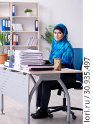Купить «Female employee in hijab working in the office», фото № 30935497, снято 20 февраля 2019 г. (c) Elnur / Фотобанк Лори