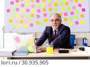 Купить «Aged man employee in conflicting priorities concept», фото № 30935905, снято 25 декабря 2018 г. (c) Elnur / Фотобанк Лори
