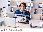 Купить «Young tied male employee in the office», фото № 30936005, снято 18 декабря 2018 г. (c) Elnur / Фотобанк Лори
