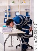Купить «Young tied male employee in the office», фото № 30936013, снято 18 декабря 2018 г. (c) Elnur / Фотобанк Лори