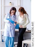 Купить «Young pregnant woman visiting experienced doctor gynecologist», фото № 30936441, снято 11 марта 2019 г. (c) Elnur / Фотобанк Лори