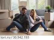Купить «Happy beautiful couple sitting back to back », фото № 30942193, снято 12 марта 2019 г. (c) Wavebreak Media / Фотобанк Лори