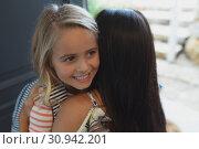 Купить «Daughter embracing her mother in a comfortable home», фото № 30942201, снято 12 марта 2019 г. (c) Wavebreak Media / Фотобанк Лори