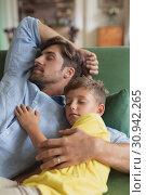 Купить «Father and son sleeping together on a sofa in living room», фото № 30942265, снято 12 марта 2019 г. (c) Wavebreak Media / Фотобанк Лори