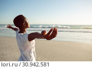 Купить «Woman performing yoga on the beach», фото № 30942581, снято 15 марта 2019 г. (c) Wavebreak Media / Фотобанк Лори