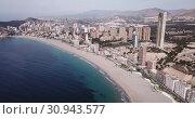 Купить «Aerial view of coast at Benidorm cityscape with a modern apartment buildings, Spain», видеоролик № 30943577, снято 17 апреля 2019 г. (c) Яков Филимонов / Фотобанк Лори