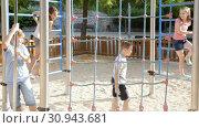 Купить «Glad children playing at the playground», видеоролик № 30943681, снято 23 июля 2018 г. (c) Яков Филимонов / Фотобанк Лори