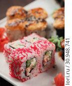 Купить «Fresh and tasty sushi on the wooden table», фото № 30948741, снято 11 апреля 2019 г. (c) Алексей Кокорин / Фотобанк Лори