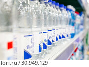 Купить «Russia Samara June 2019: bottles with pure fresh mineral water on the counter in the supermarket. Text in Russian: Volzhanka», фото № 30949129, снято 5 июня 2019 г. (c) Акиньшин Владимир / Фотобанк Лори