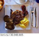 Купить «Plate of tasty roasted mutton», фото № 30949805, снято 17 июля 2019 г. (c) Яков Филимонов / Фотобанк Лори