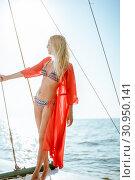 Купить «Young beautiful slim sexy girl in bikini and pareo is resting on cruise on a private sailing yacht», фото № 30950141, снято 25 июля 2017 г. (c) katalinks / Фотобанк Лори