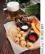 Купить «Big set of snacks for beer it includes fried cheese balls, pigtail cheese, fried dumplings», фото № 30950881, снято 18 февраля 2019 г. (c) Алексей Кокорин / Фотобанк Лори