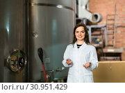 Купить «Woman at olive oil factory», фото № 30951429, снято 27 июня 2019 г. (c) Яков Филимонов / Фотобанк Лори
