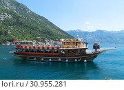 Купить «Perast, Montenegro - June 10. 2019. Beautiful excursion boat in a Boka-Kotorska bay», фото № 30955281, снято 10 июня 2019 г. (c) Володина Ольга / Фотобанк Лори