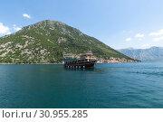 Купить «Perast, Montenegro - June 10. 2019. Beautiful excursion boat in a Boka-Kotorska bay», фото № 30955285, снято 10 июня 2019 г. (c) Володина Ольга / Фотобанк Лори