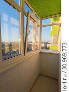 Купить «A small glazed balcony in the apartment of a multi-storey residential building», фото № 30969773, снято 19 сентября 2018 г. (c) easy Fotostock / Фотобанк Лори