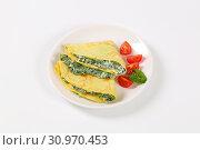 Купить «Thin pancakes (crepes) stuffed with spinach and cheese», фото № 30970453, снято 1 ноября 2016 г. (c) easy Fotostock / Фотобанк Лори