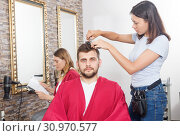 Woman professional hairdresser cut male's hair in hairdressing salon. Стоковое фото, фотограф Яков Филимонов / Фотобанк Лори