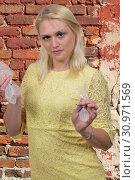Купить «Woman illegally price gouging on a sale of water rations», фото № 30971569, снято 20 июня 2019 г. (c) easy Fotostock / Фотобанк Лори