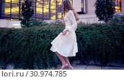 Купить «Girl runs on high heels stiletto in street city outdoor», видеоролик № 30974785, снято 10 мая 2019 г. (c) Gennadiy Poznyakov / Фотобанк Лори