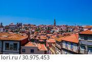 Купить «View over the rooftops of the city from the Cathedral, looking towards the Clerigos Tower, Porto, Portugal», фото № 30975453, снято 17 июля 2018 г. (c) Николай Коржов / Фотобанк Лори