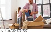 Купить «happy couple with stuff moving to new home», видеоролик № 30975737, снято 10 июня 2019 г. (c) Syda Productions / Фотобанк Лори