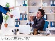 Купить «Young male employee being fired from his work», фото № 30976197, снято 18 февраля 2019 г. (c) Elnur / Фотобанк Лори