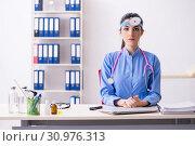 Купить «Young female doctor working in the clinic», фото № 30976313, снято 16 января 2019 г. (c) Elnur / Фотобанк Лори