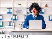 Купить «Young clown businessman working in the office», фото № 30978845, снято 14 декабря 2018 г. (c) Elnur / Фотобанк Лори