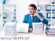 Купить «Young male employee unhappy with excessive work», фото № 30979121, снято 26 февраля 2019 г. (c) Elnur / Фотобанк Лори