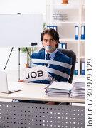 Купить «Young tied male employee in the office», фото № 30979129, снято 18 декабря 2018 г. (c) Elnur / Фотобанк Лори