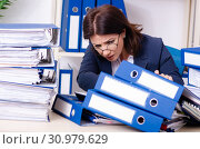 Middle-aged businesswoman unhappy with excessive work. Стоковое фото, фотограф Elnur / Фотобанк Лори