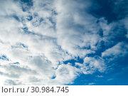 Купить «Colorful sky background - blue dramatic colorful clouds lit by evening sunshine», фото № 30984745, снято 26 октября 2018 г. (c) Зезелина Марина / Фотобанк Лори