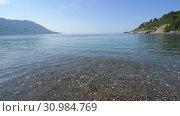 Купить «Fragment of the sea coast in Montenegro», видеоролик № 30984769, снято 11 июня 2019 г. (c) Володина Ольга / Фотобанк Лори