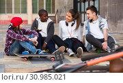 Купить «teens chatting near bikes», фото № 30985021, снято 26 июня 2019 г. (c) Яков Филимонов / Фотобанк Лори