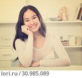 Купить «Positive teenager girl smiling at home», фото № 30985089, снято 30 мая 2017 г. (c) Яков Филимонов / Фотобанк Лори