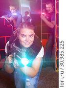 Купить «glad girl with laser pistol playing laser tag with friends», фото № 30985225, снято 3 сентября 2018 г. (c) Яков Филимонов / Фотобанк Лори
