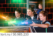 Купить «Happy brother and sister with laser pistols playing laser tag wi», фото № 30985233, снято 3 сентября 2018 г. (c) Яков Филимонов / Фотобанк Лори