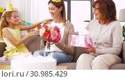 Купить «daughter with gift box greeting mother on birthday», видеоролик № 30985429, снято 14 июня 2019 г. (c) Syda Productions / Фотобанк Лори