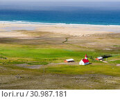 Settlement and beach at Breidavik. The remote Westfjords (Vestfirdir) in north west Iceland. Europe, Scandinavia, Iceland. Стоковое фото, фотограф Martin Zwick / age Fotostock / Фотобанк Лори