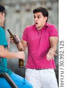 Купить «interested male fans are drinking beer and talking about football outdoor in Barcelona», фото № 30992125, снято 19 августа 2017 г. (c) Яков Филимонов / Фотобанк Лори