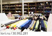 Купить «different fabric bolts exposed on shelves», фото № 30992281, снято 2 марта 2018 г. (c) Яков Филимонов / Фотобанк Лори